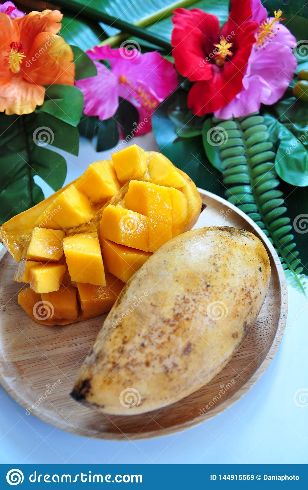 Close up Sweet Mango on Wooden Plate