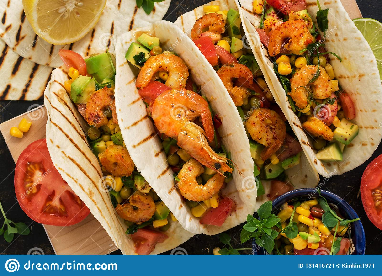 Close up tacos with shrimp. Mexican traditional snack. View from above.