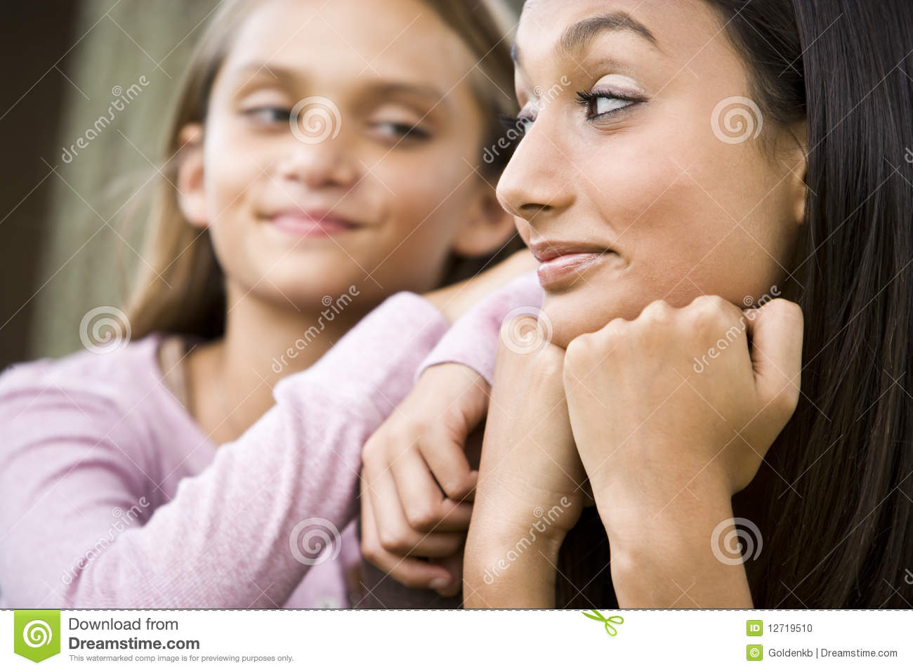 Close-up of teenage girl and younger sister