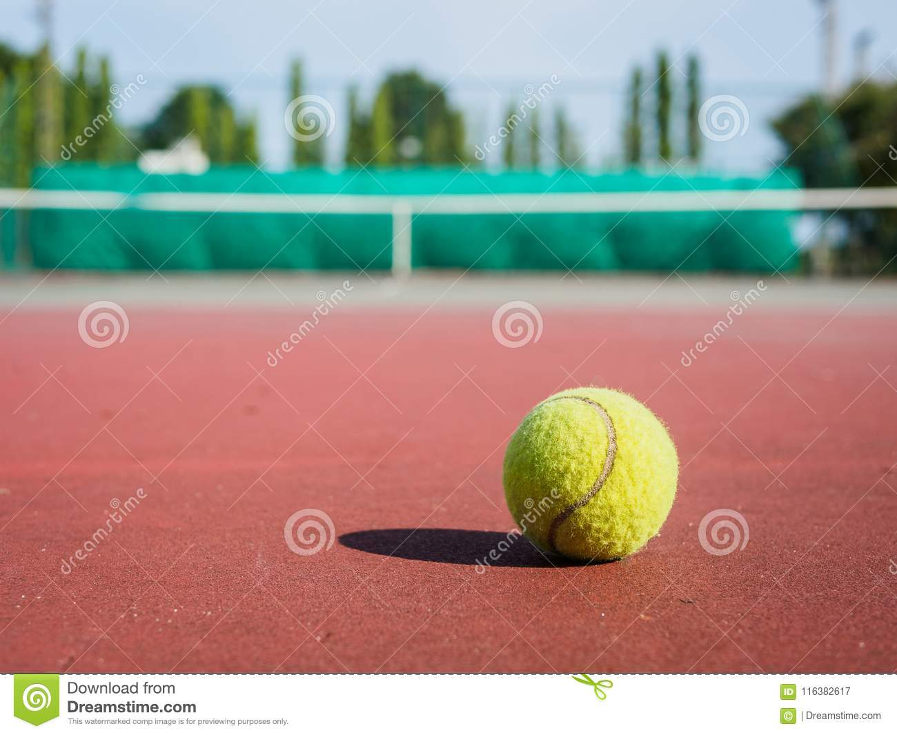 Close up of tennis ball on the court. Sport active concept.