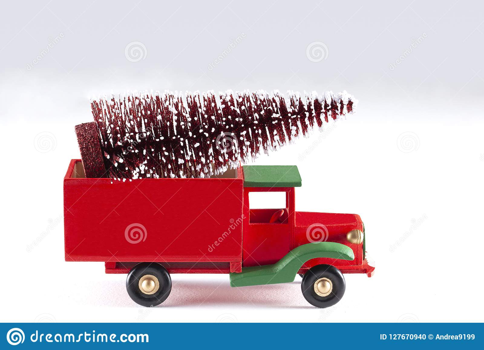 Close Up On A Toy Car With Christmas Tree Isolated On White