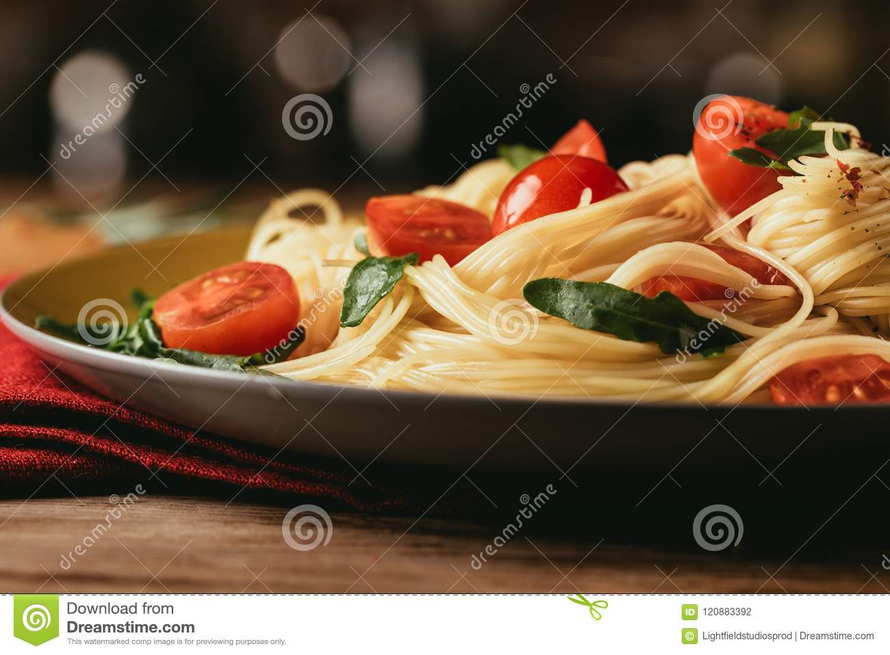 close up of traditional italian pasta with tomatoes and arugula