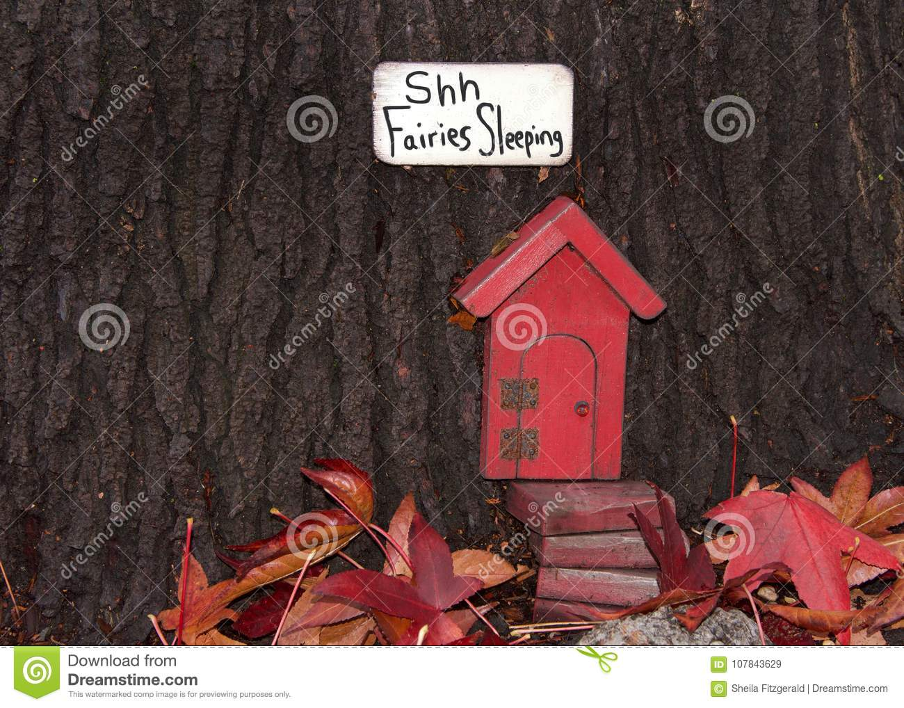 Whimsical Red Fairy Door In A Tree Trunk Stock Image Image Of