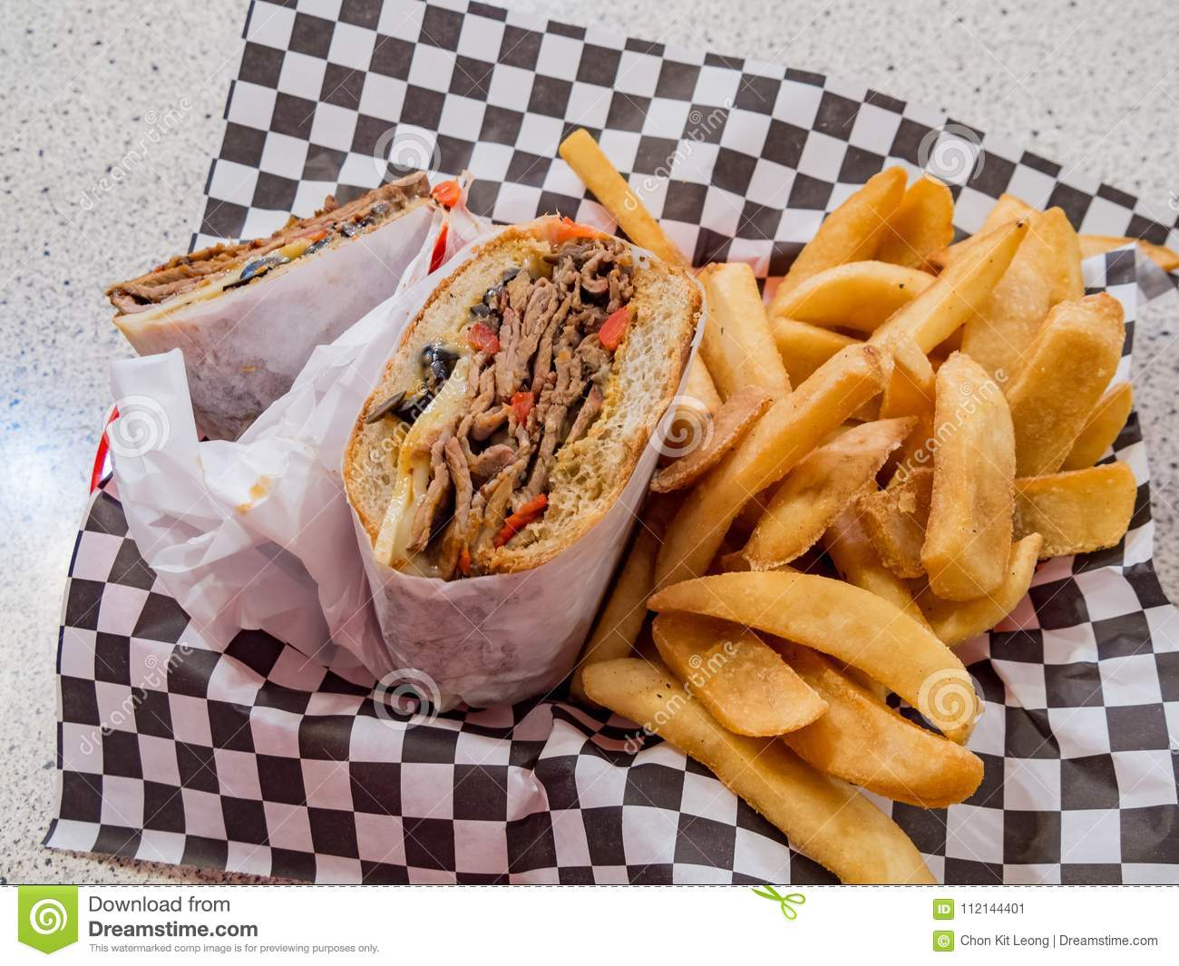 Close up of Tri-tip steak sandwich with french fries