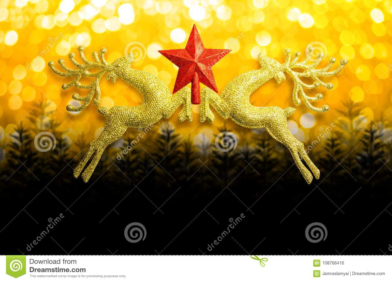 Two golden reindeer with red star on circular bokeh yellow gold background and copy space, concept christmas day.