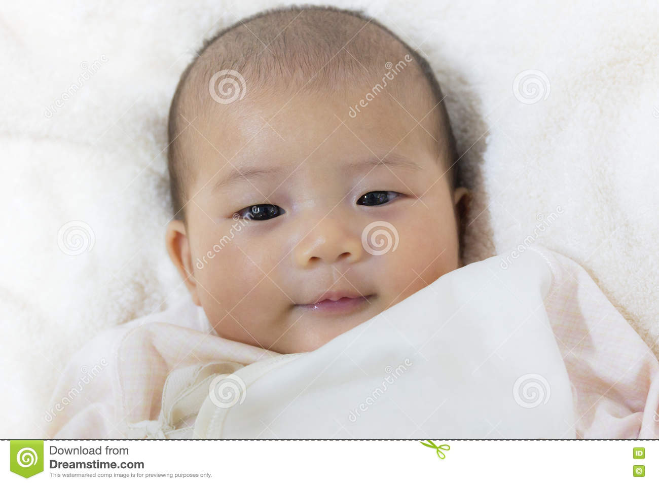 Close up two month old new born asian cute baby smile rests ha