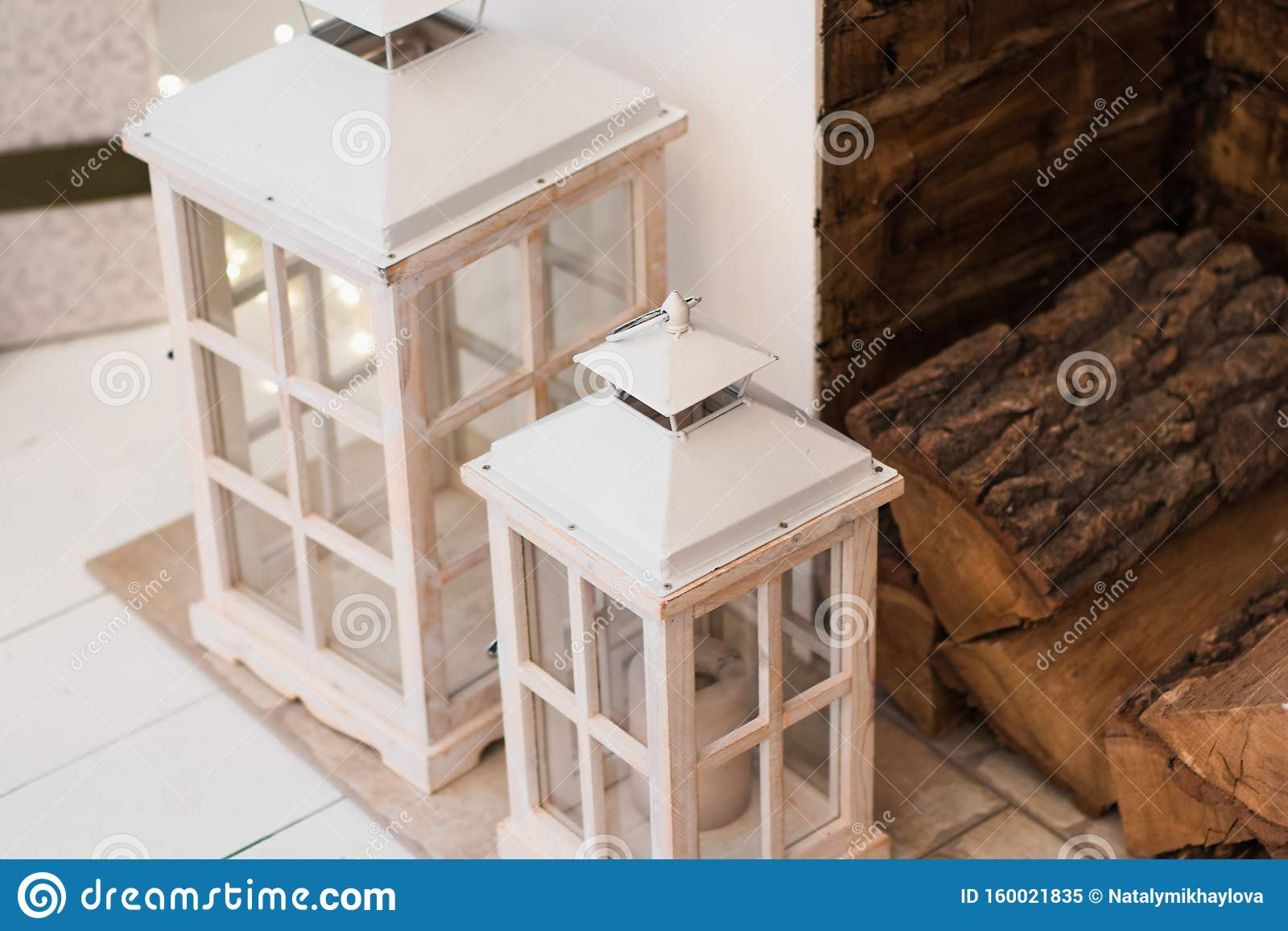 Close Up Of Two White Wooden Lanterns Next To The Fireplace Winter Christmas Design Of Interior Stock Image Image Of Decoration Building 160021835