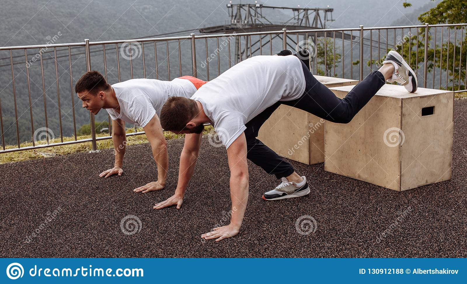 Two Young Athletes Doing Push-ups Outdoors  Stock Photo