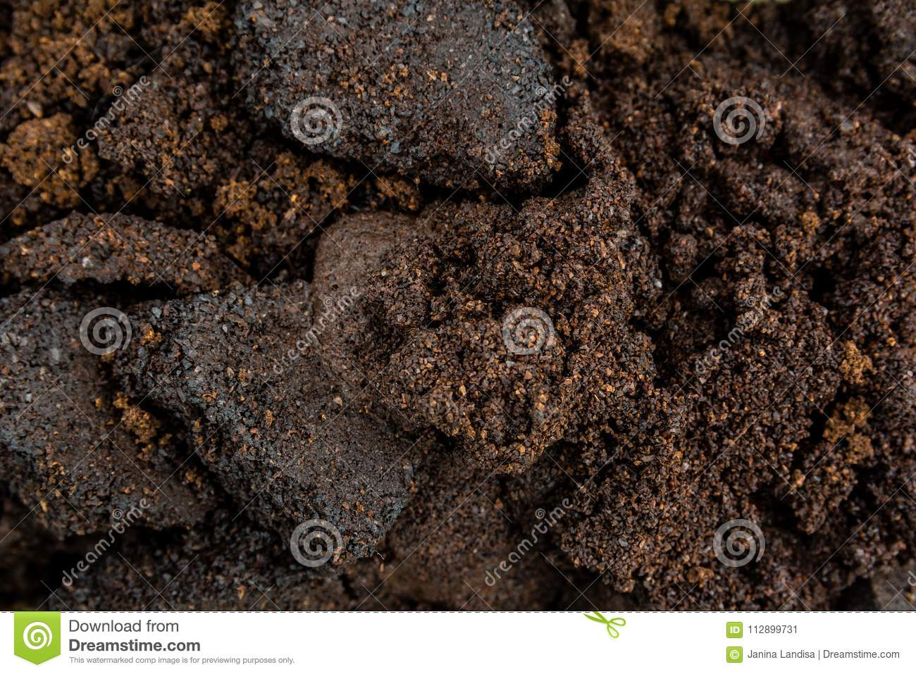 Close up of used coffee or garbage as background, pattern, text