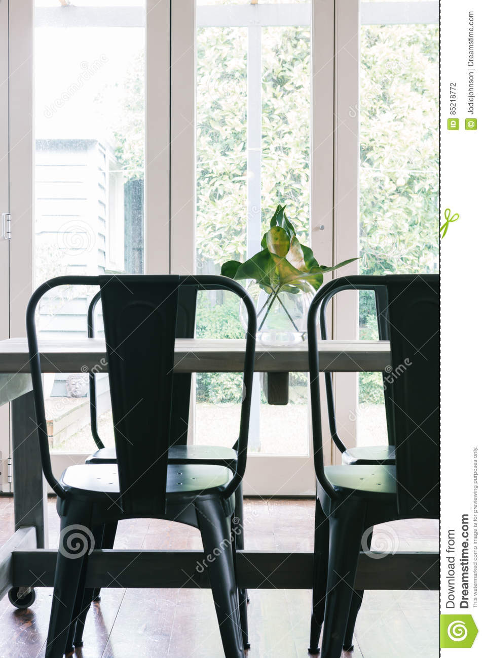 Close Up Vertical Of Black Metal Industrial Style Dining Table Stock