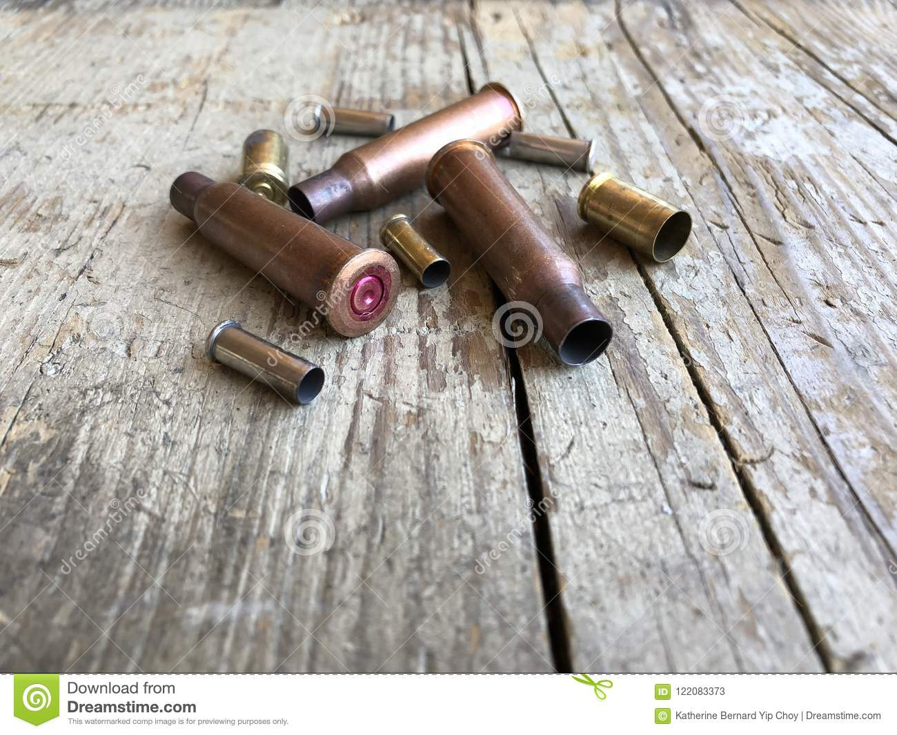 Close up view of ammunition casings on a wood background