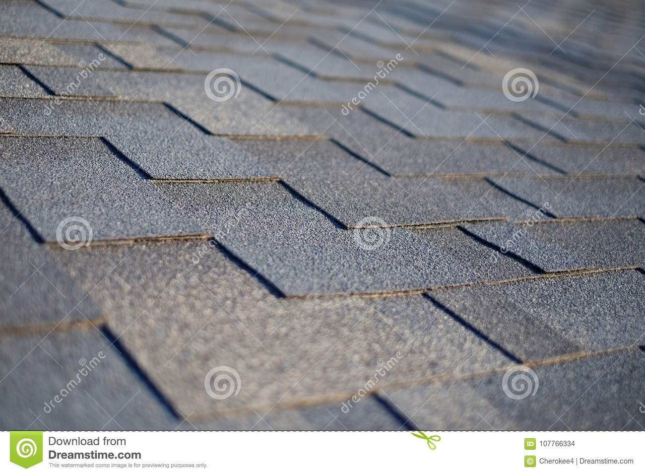 Close up view on Asphalt Roofing Shingles Background. Roof Shingles - Roofing