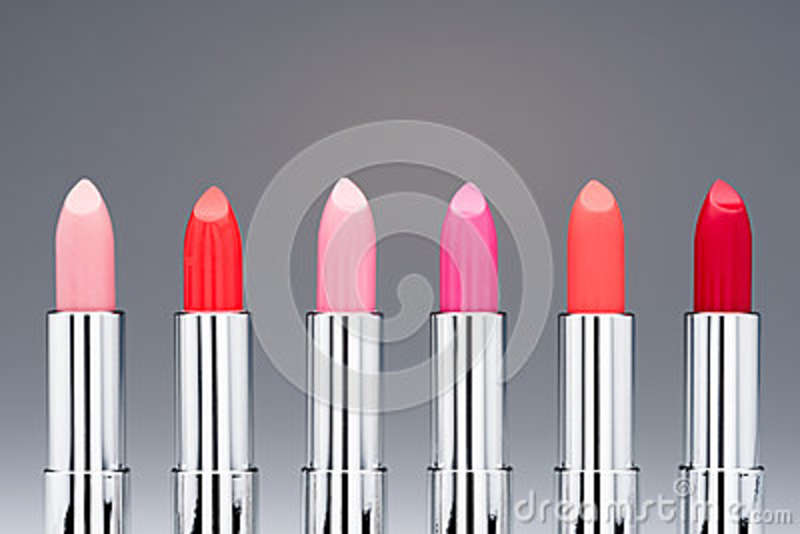 Close-up view of collection of fashionable glossy lipsticks in row