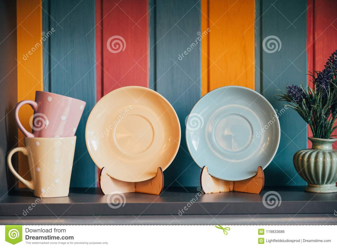 Close-up View Of Decorative Empty Plates And Cups Near Colorful Wall ...