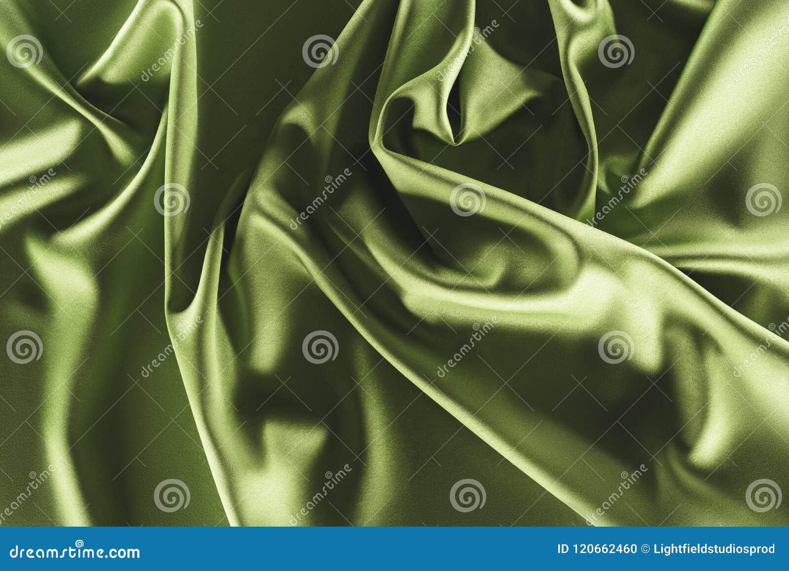 close up view of elegant green silk cloth