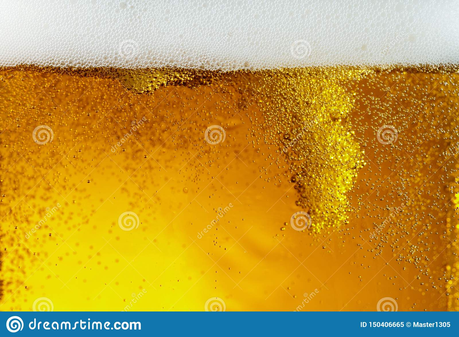 Close up view of floating bubbles in light beer texture