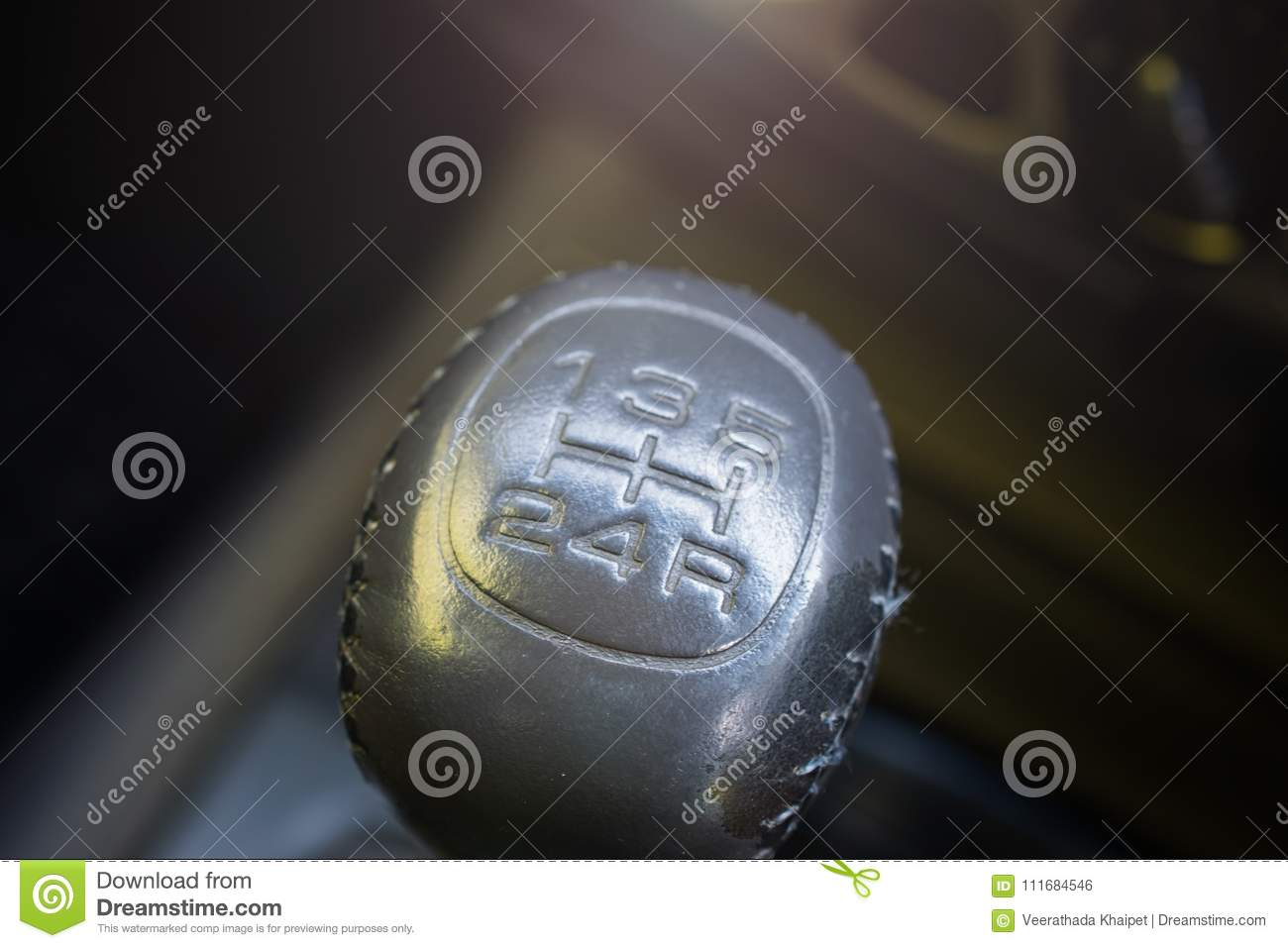 Close up view of a gear lever shift. Car interior