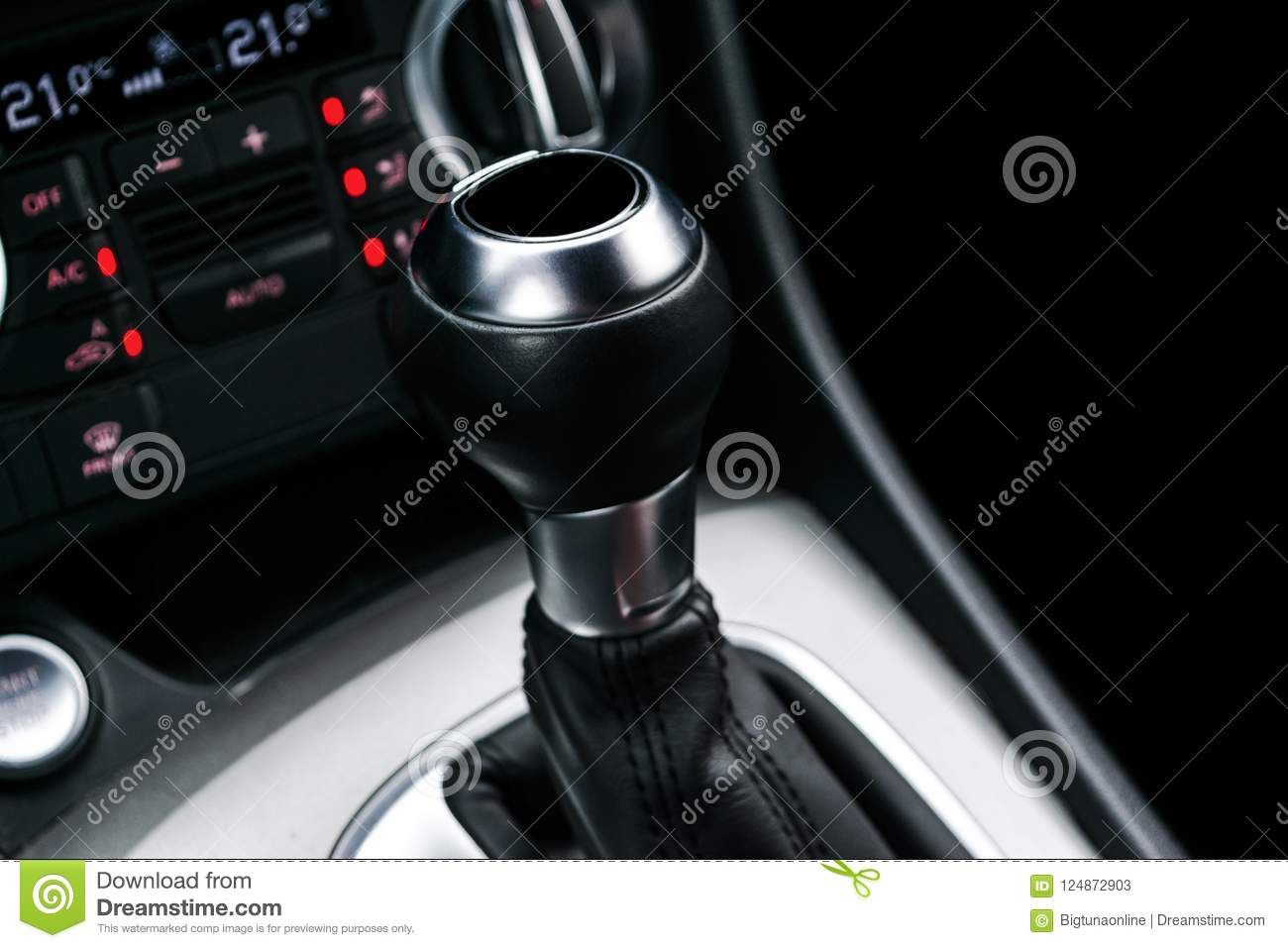 Close up view of a gear lever shift. Manual gearbox. Car interior details. Car transmission. Soft lighting. Abstract view. Car det