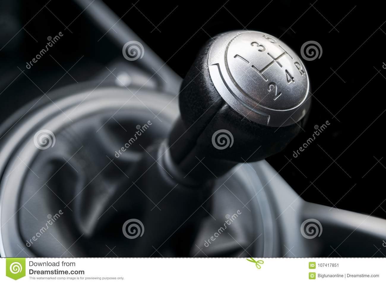 Close up view of a gear lever shift. Manual gearbox. Car interior details. Car transmission. Soft lighting. Abstract view