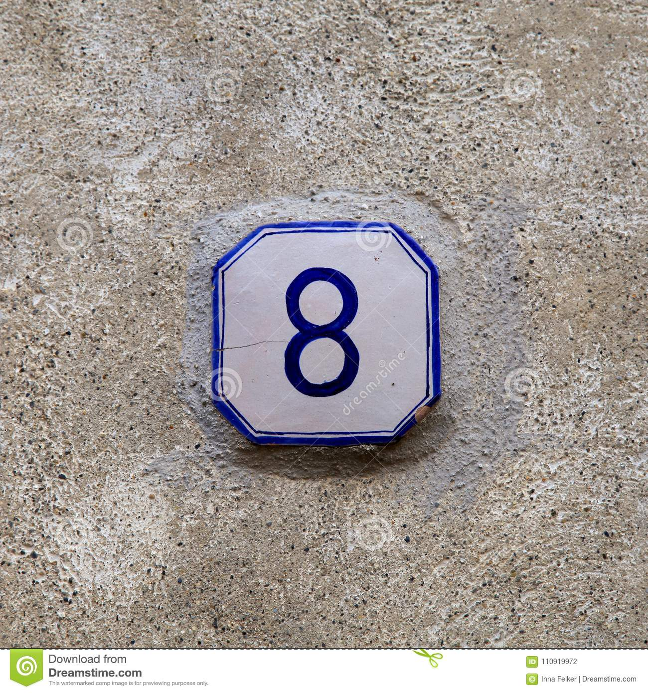 Number 8 eight on blue and white ceramic sign.