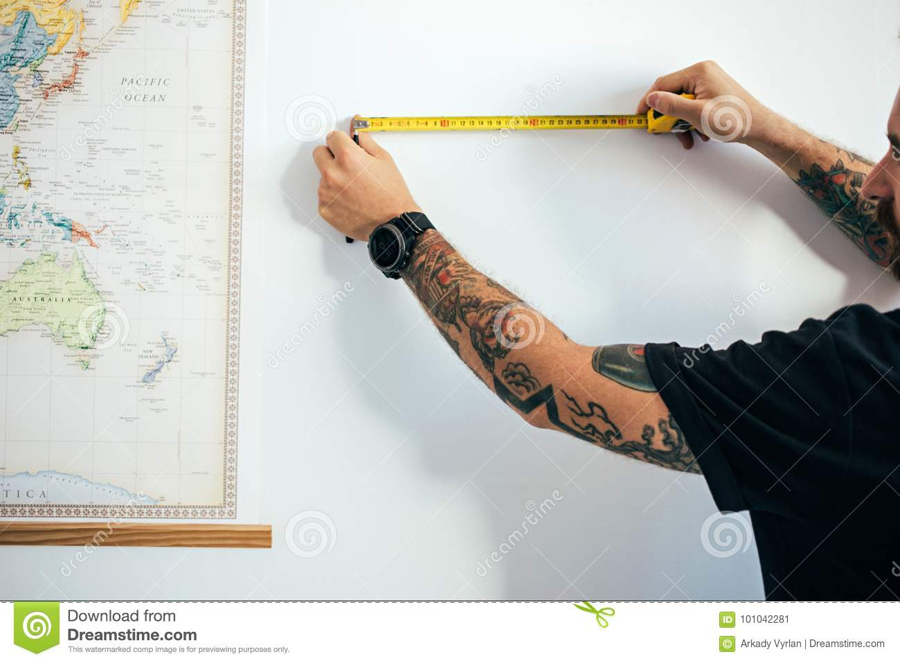 df56f3440 Close up view on male arms with tattoos, with watch uses measuring tape to  establish construction work measurments, prepares new house or condo for  moving ...