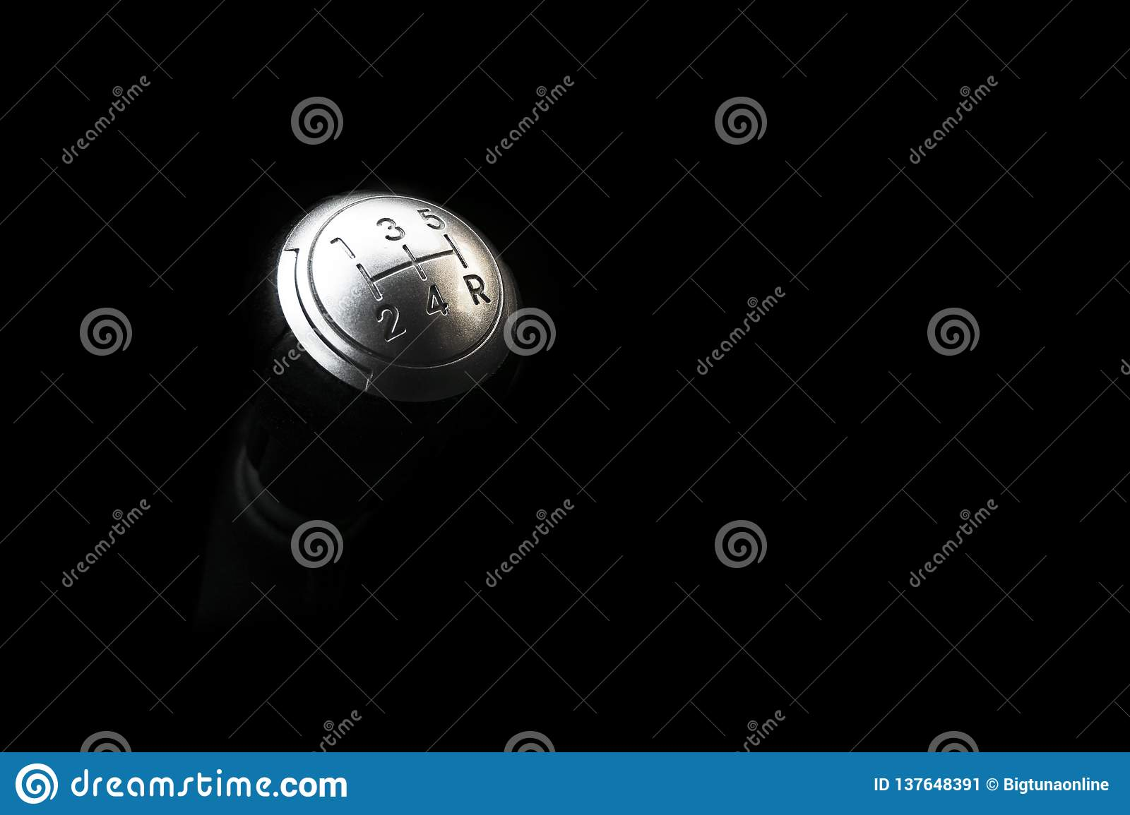 Close up view of a manual gear lever shift isolated on black background. Manual gearbox. Car interior details. Car transmission.Cl
