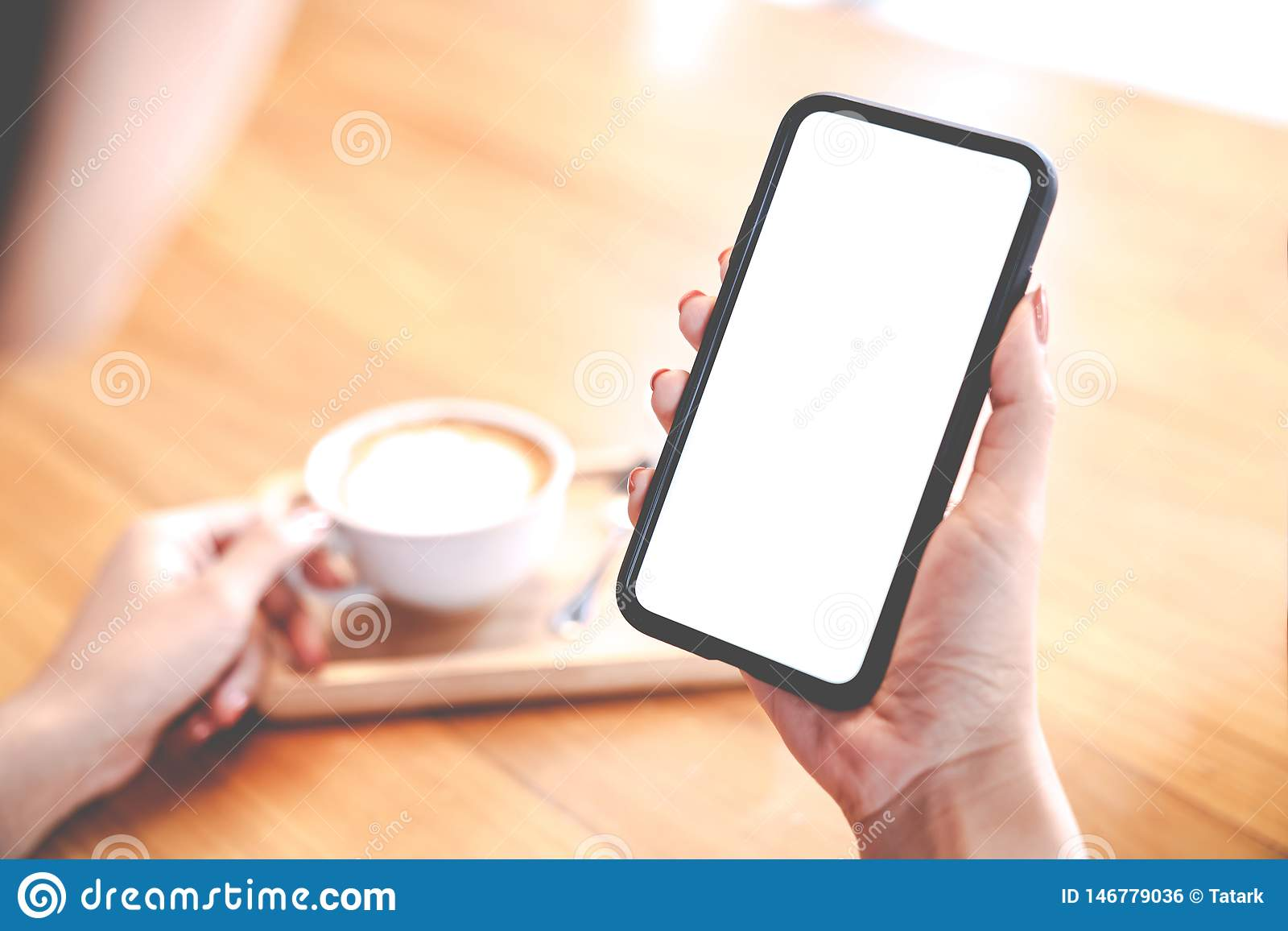 Close up view of Mockup image white screen smartphone on woman`s hand. Blank copy space screen for your advertising text message