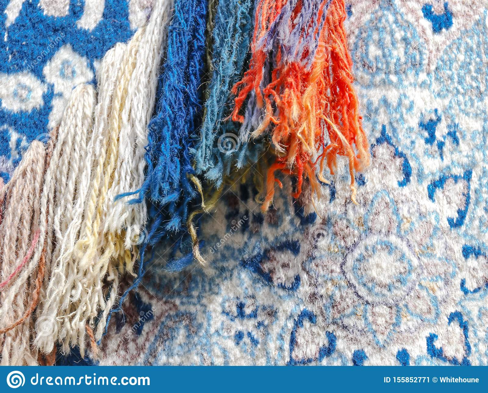 Abstract colorful background with close up view of an old carpet
