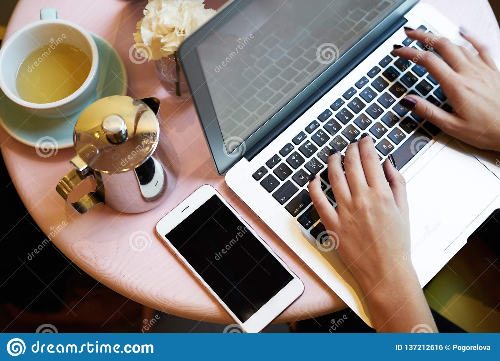 Close Up view of opened laptop screen, business woman working at sunny office near window daylight. Meeting in co-working or cafe,