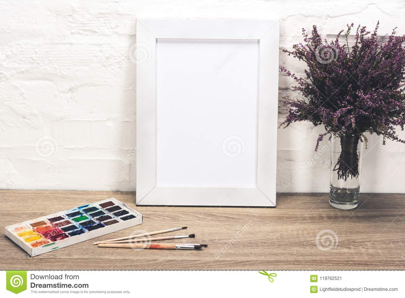 close up view of photo frame, lavender flowers in vase and drawing equipment