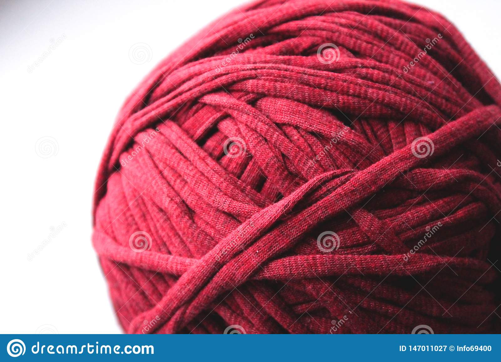 Close up view of red clew thread for knitting