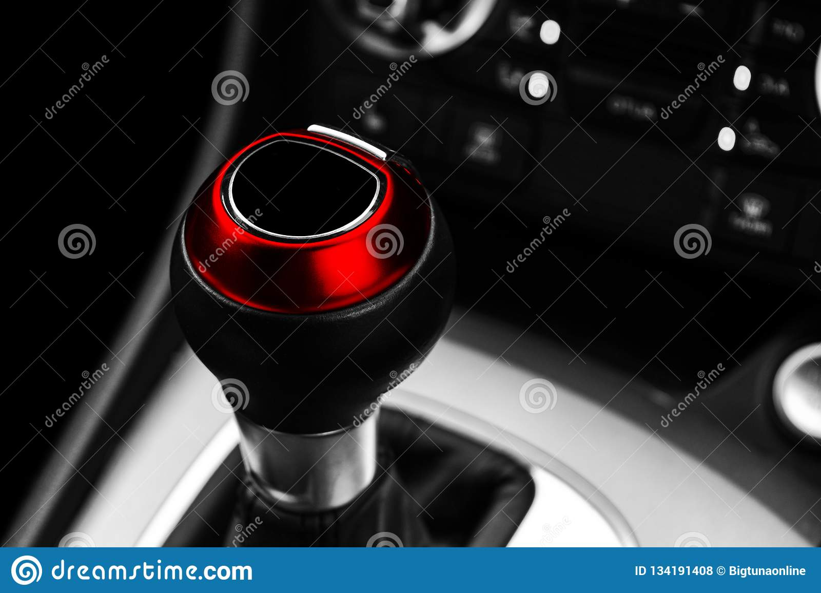 Close up view of a red gear lever shift. Manual gearbox. Car interior details. Car transmission. Soft lighting. Abstract view. Car