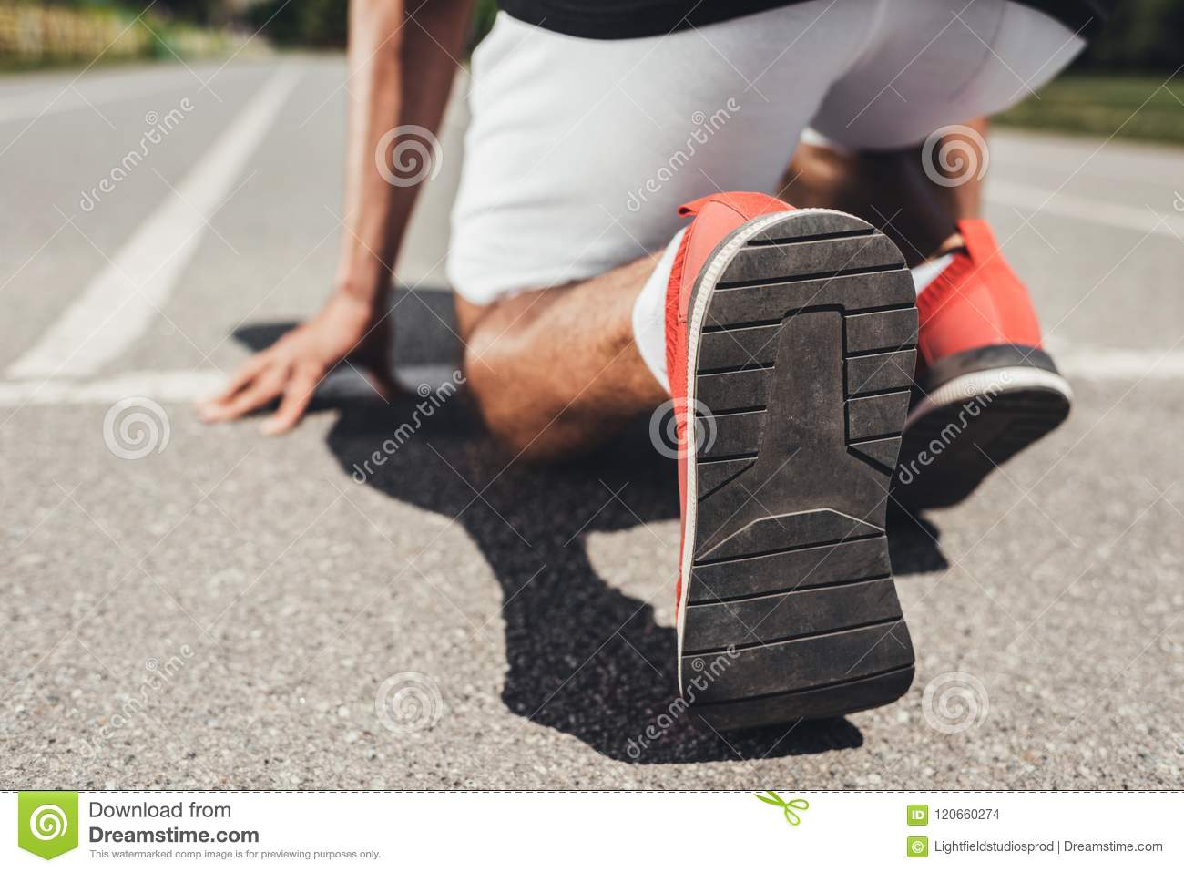 close up view of running shoes of male sprinter in starting position