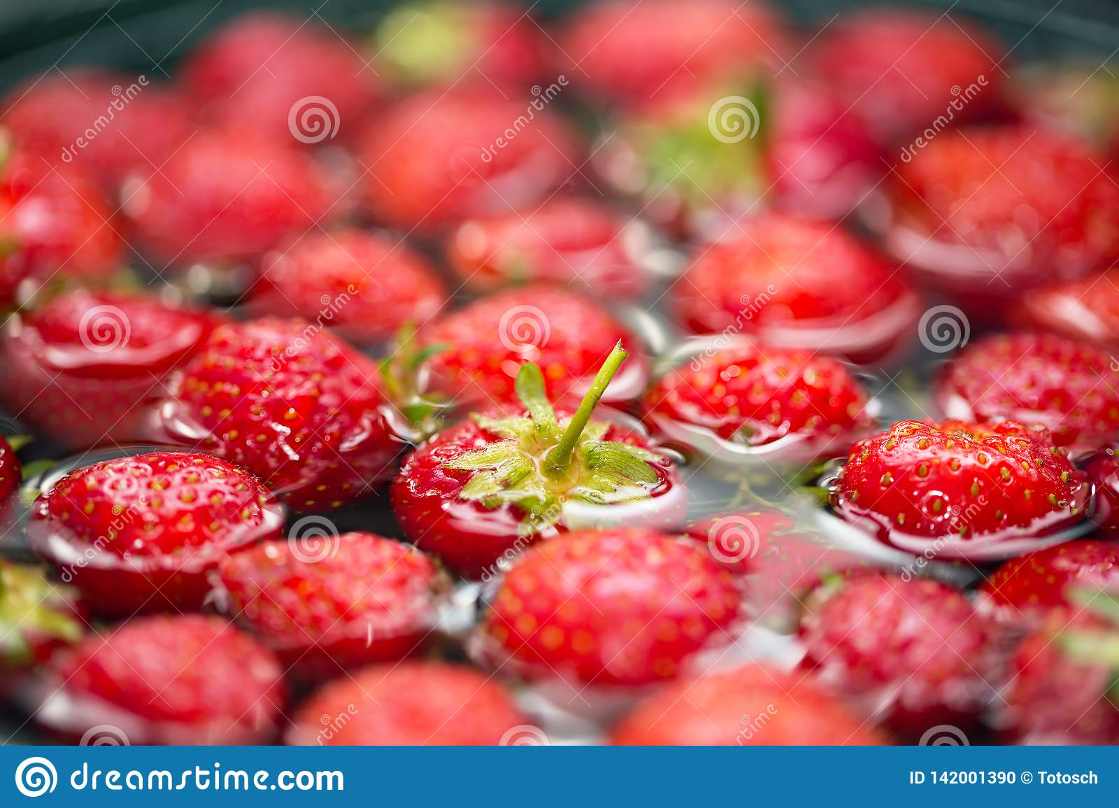 Close-up view of strawberries in water