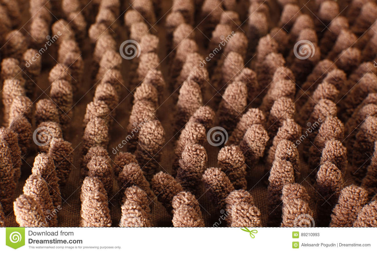 Close Up Photo Of Brown Surface: Close Up View At The Surface Of The Fabric Brown Carpet