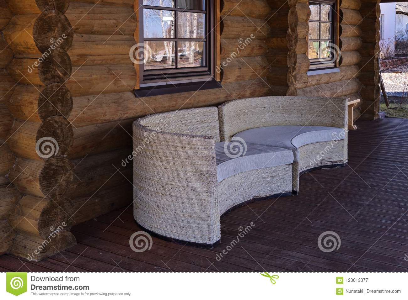 Close Up View Of White Sofas On Log House Terrace Stock