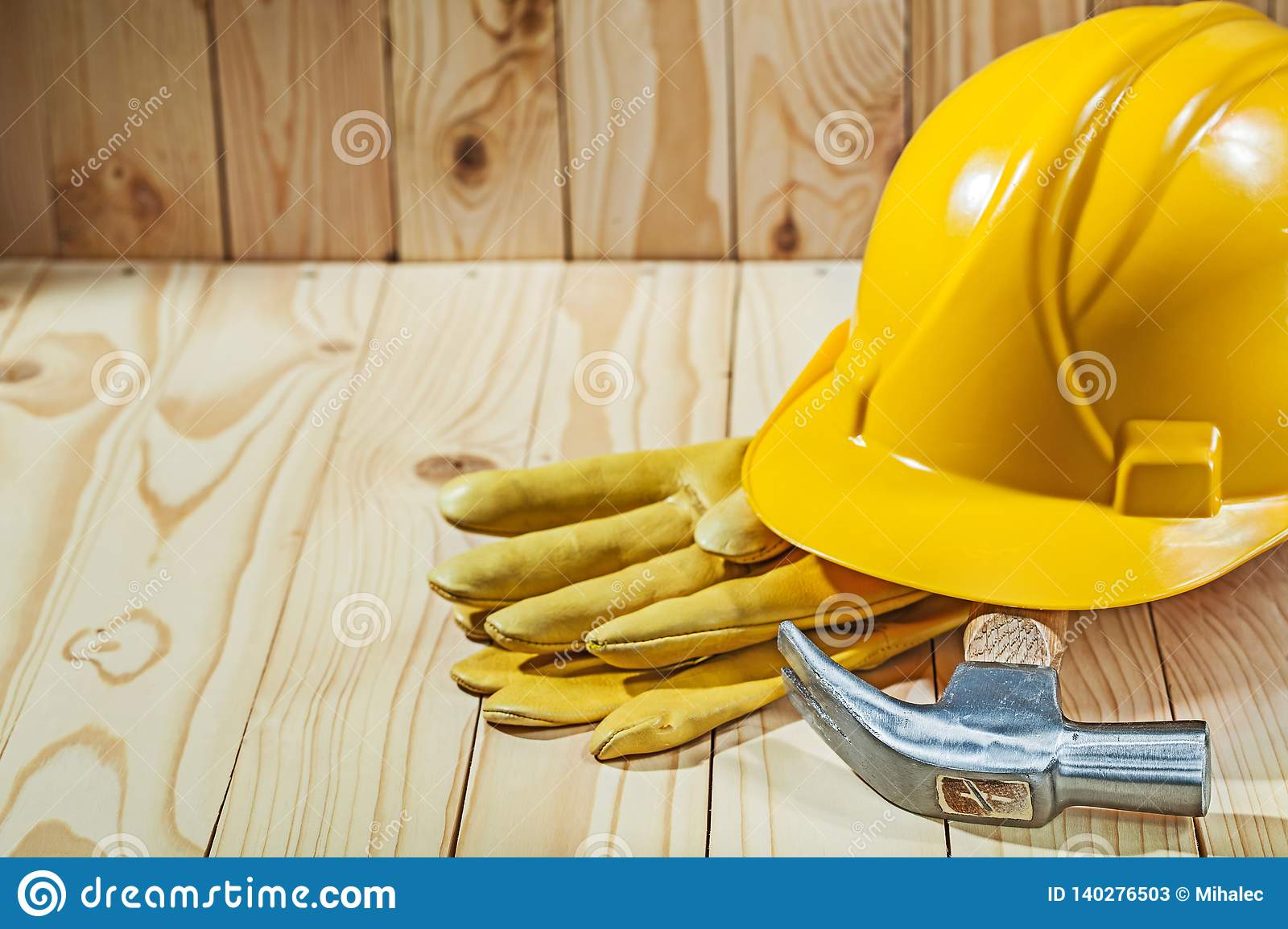 Close up view working gloves claw hammer and helmet