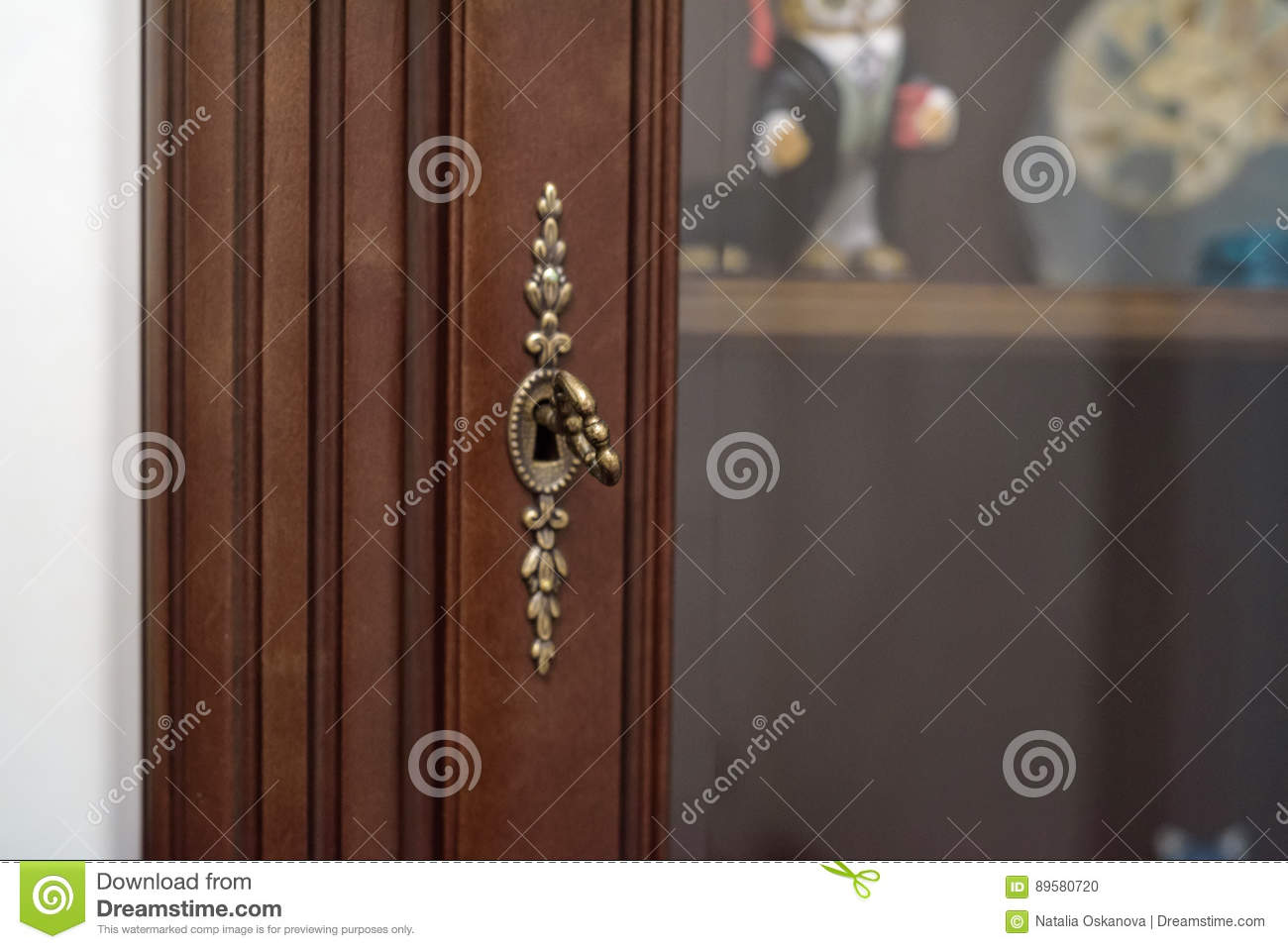 Close up vintage key in keyhole stock photo