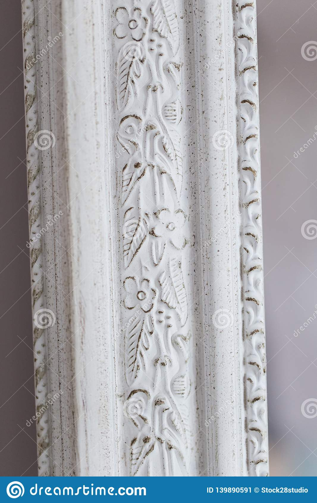 Close-up of a vintage mirror with decorative ornaments