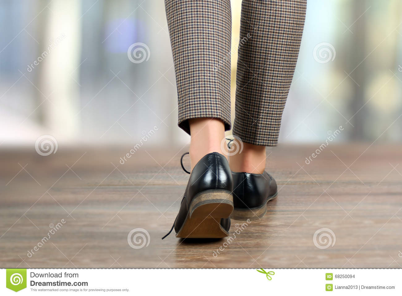 Close Up Of Walking Woman Feet In Black Shoes On The Floor