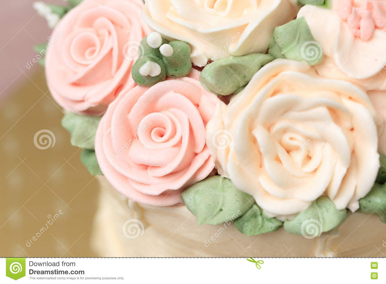 Close Up Of Wedding Or Birthday Cake Decorated With Flowers Made From Cream
