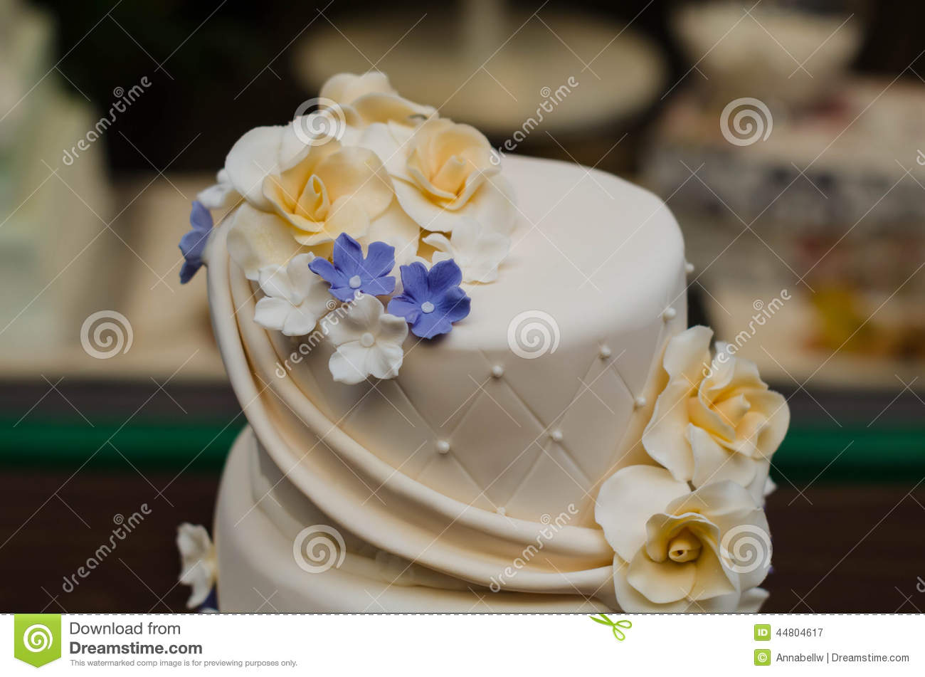 Close up wedding cake with yellow and purple flowers stock image close up wedding cake with yellow and purple flowers mightylinksfo