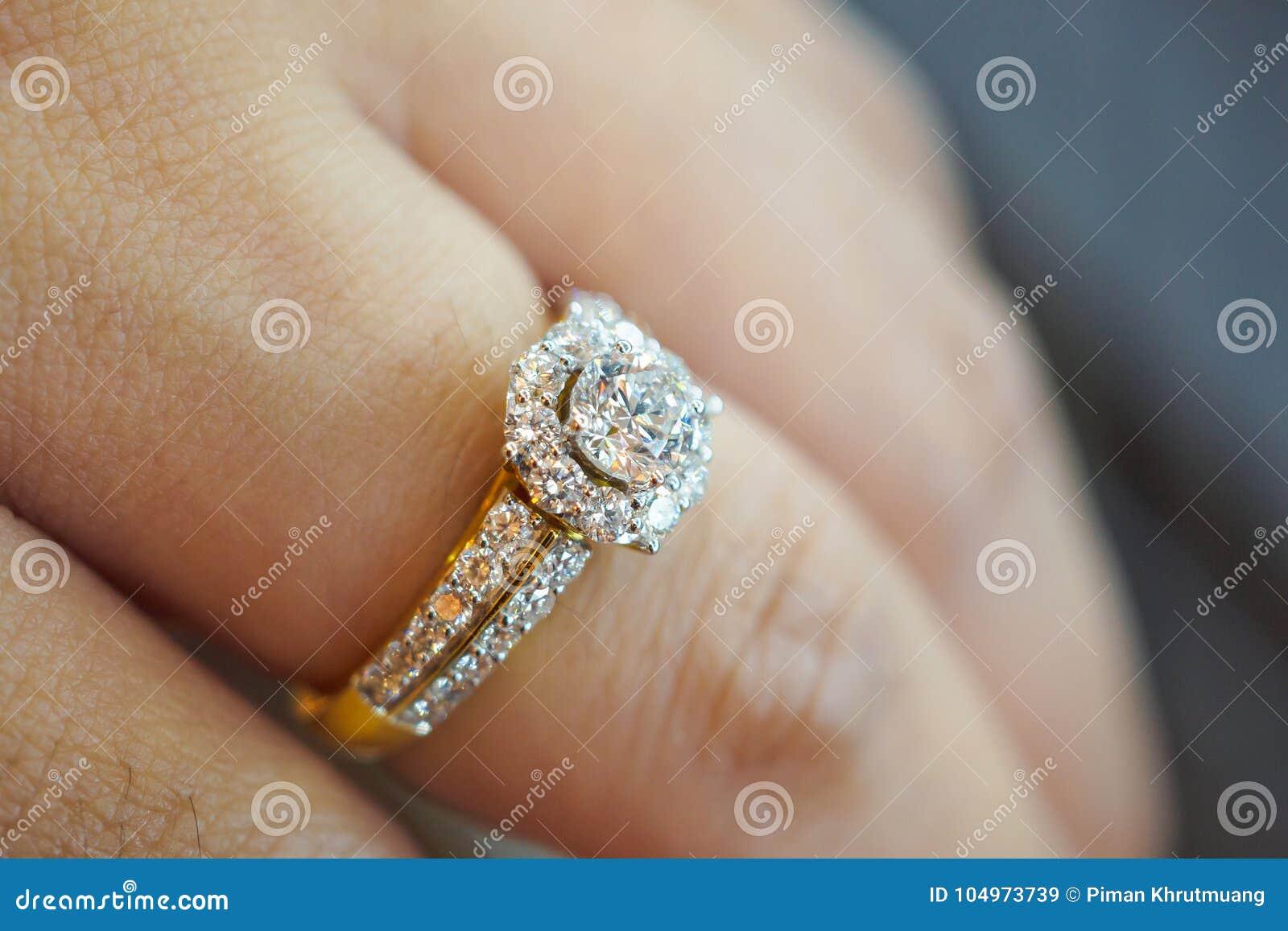 Wedding diamond ring on woman finger