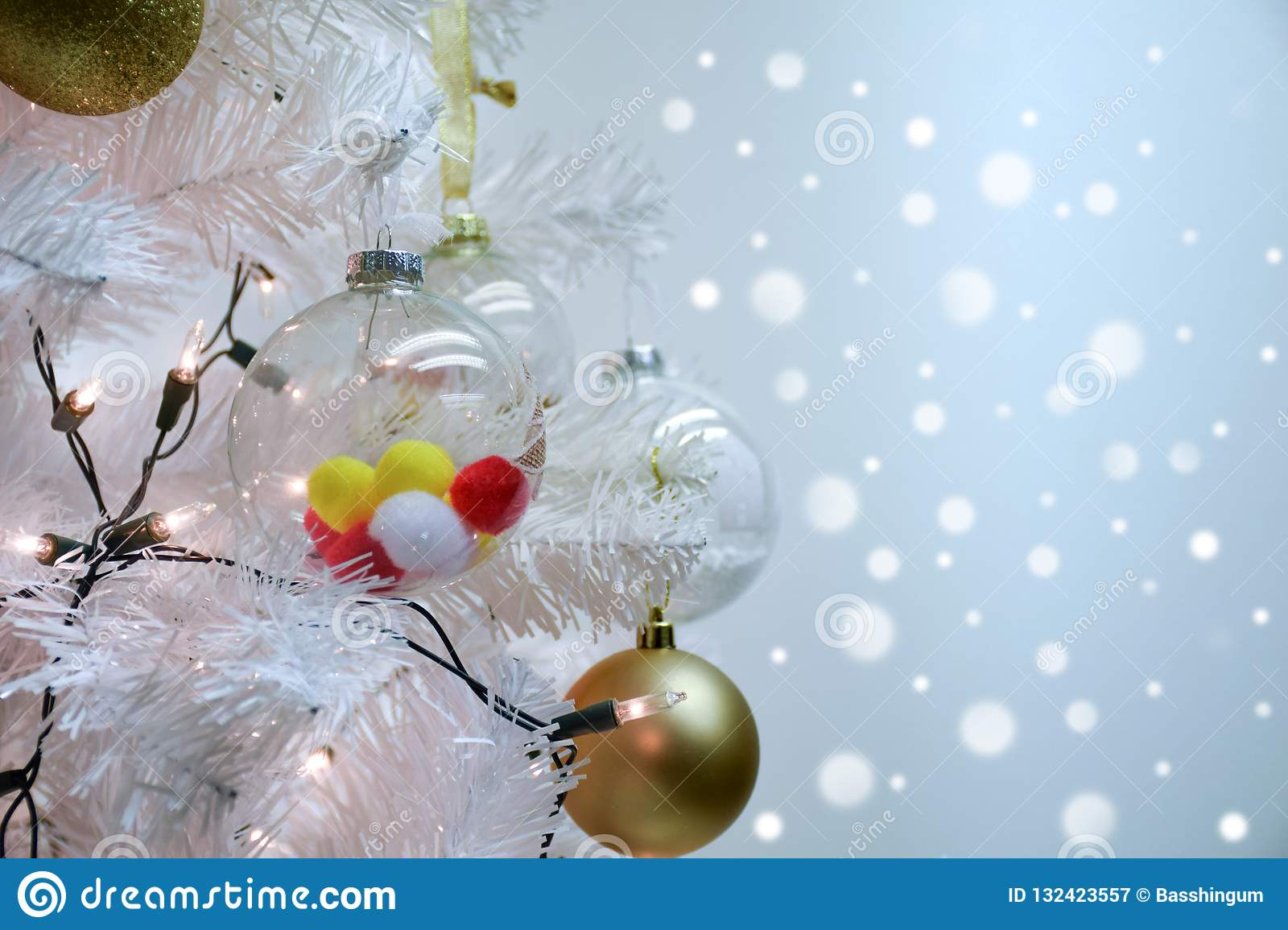 Close up white christmas and pom poms ball on fir branches with bokeh background