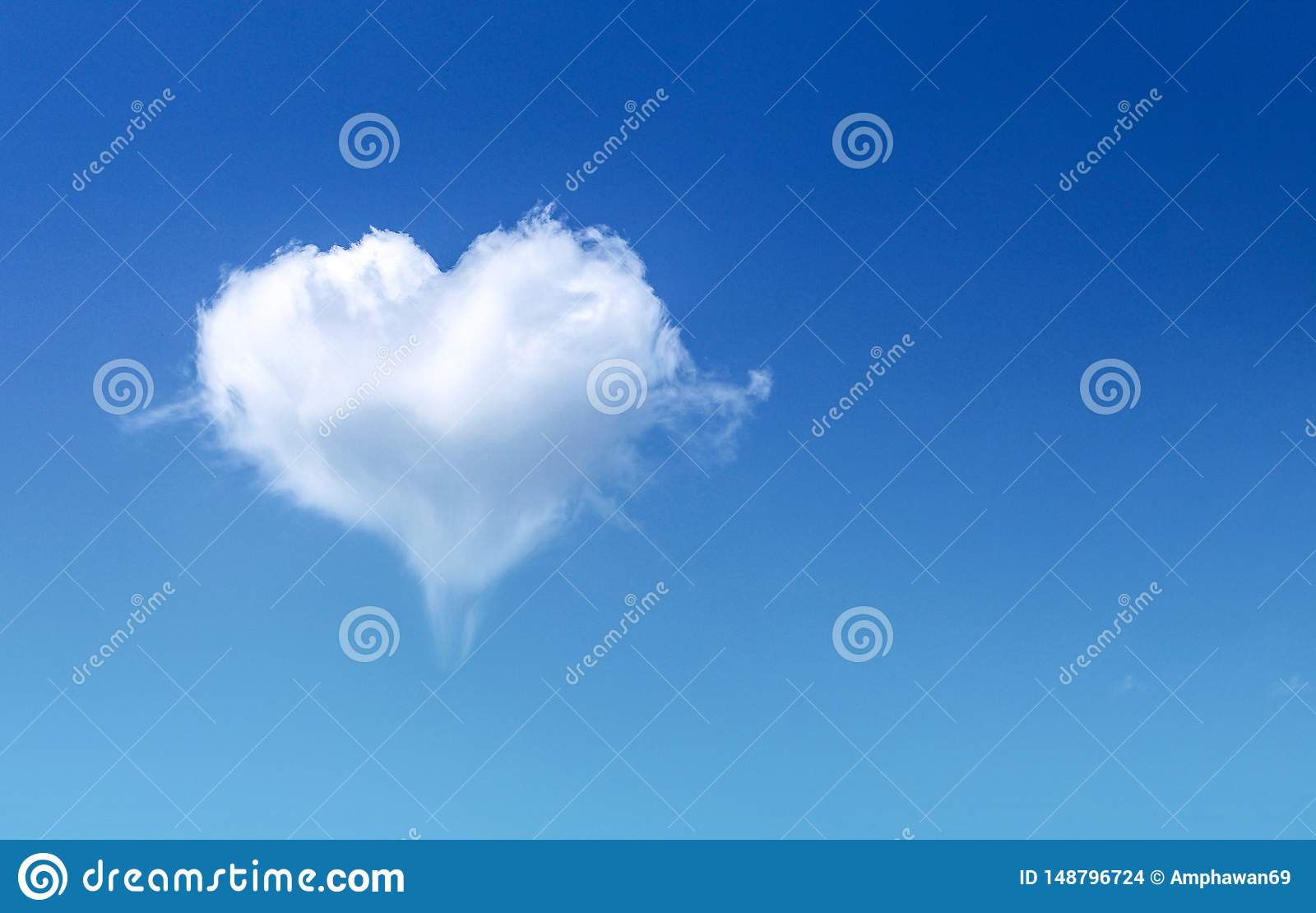 White fluffy heart shaped cloud patterns soft focus on clear blue sky and copy space , Valentines day background