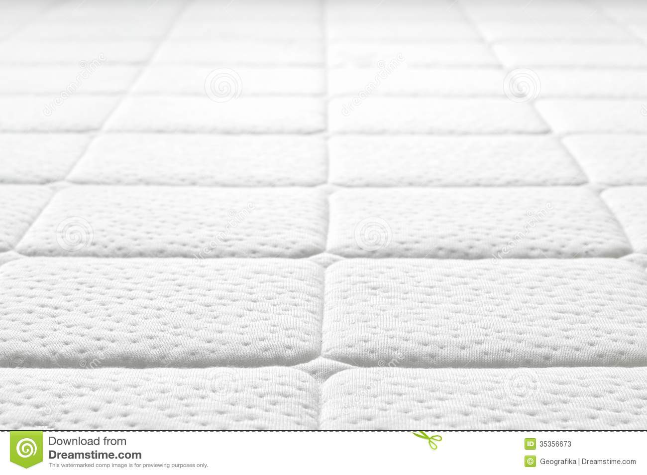 mattress texture. Close-up Of White Mattress Texture. Patter Quilted Material. Comfortable Mattress. Texture H