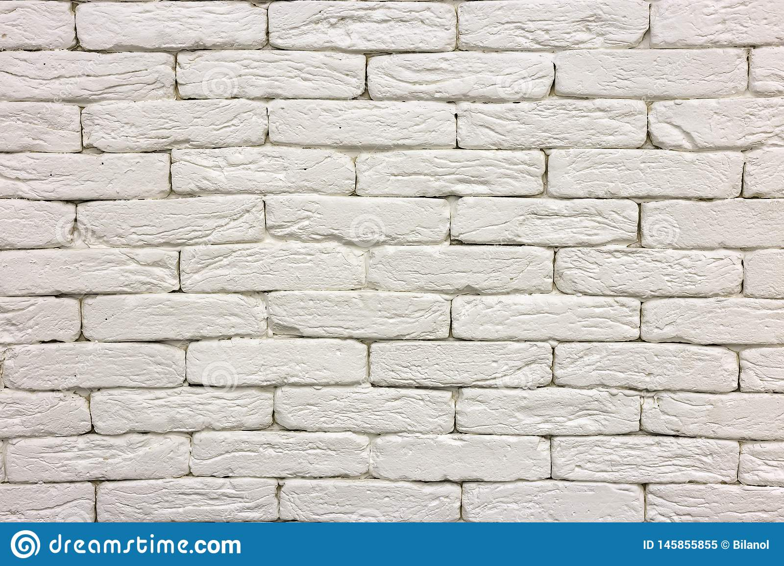 Close Up Of White Painted Whitewashed Solid Brick Wall