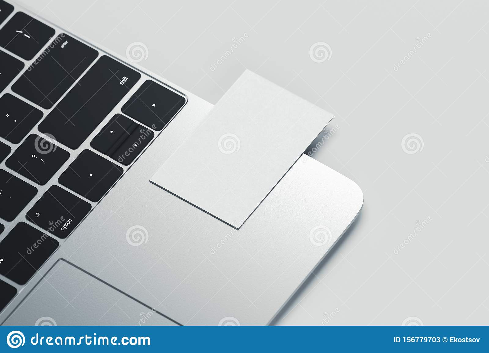 Close up of white realistic modern business card on laptop on light background. 3d rendering.