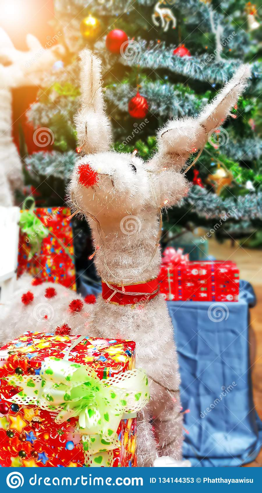 Close Up White Reindeer, Christmas Tree Decorations And ...