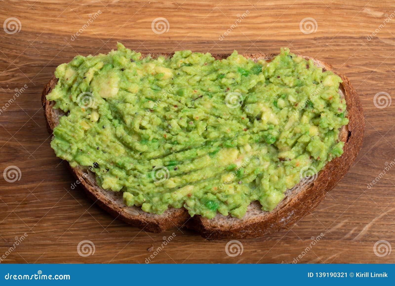 Wholewheat toast with mashed avocado